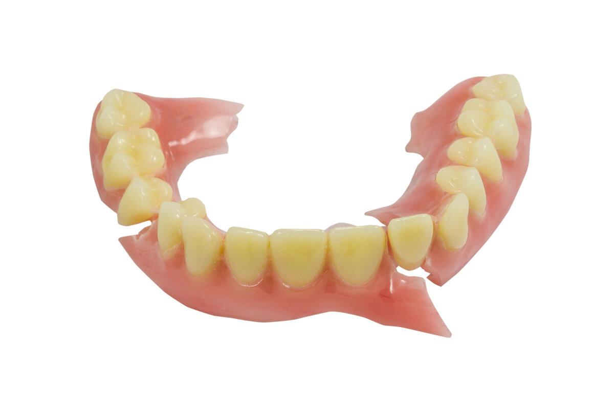 27768249 - broken denture isolate on white background